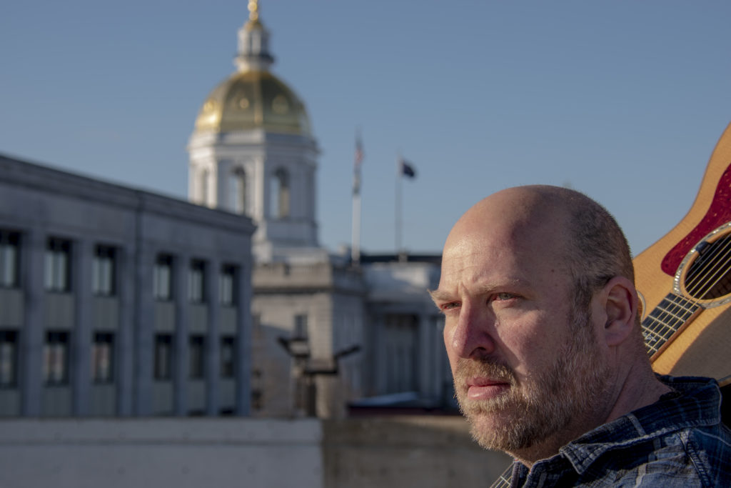 Joe Messineo State of NH Capitol dome in background.